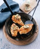 Fried chicken breast fillets with mustard and tarragon butter