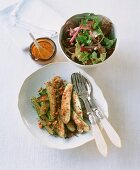 Breaded courgettes and a mixed leaf salad