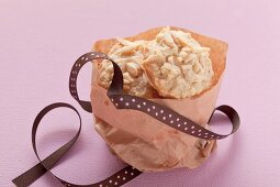 Vanilla cookies with almond slivers in a paper bag