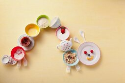 Caterpillar of colourful crockery with breakfast foods