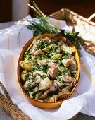 Braised rabbit with artichokes and mixed herbs