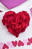 Rose petals arranged in heart