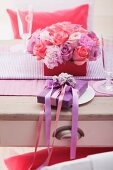 Table with flower arrangement and present