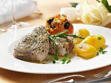 Sword fish steaks with roast potatoes and stuffed tomatoes