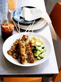 Pork entree with vegetable side dish (Asia)