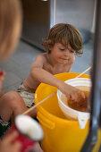 A boy tasting fresh honey