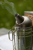A smoker (bee-keeping equipment)