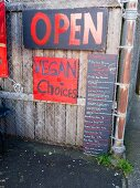 Menu board for a vegan food at a Farmer's Market in Portland, Oregon