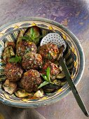 Chilli and pepper meatballs on fried aubergine