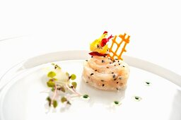 Sea bass carpaccio with lemon and olive oil marinade, sesame, vegetable lattice and basil oil