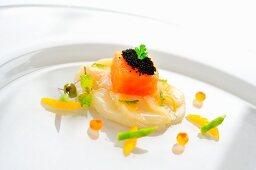 Scallop carpaccio with tuna and orange and mint dressing