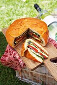 Stuffed bread for a picnic outside on a wooden board