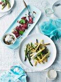 Wagyu beef carpaccio with asparagus salad