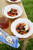 Berries with candied oranges and caramel sauce