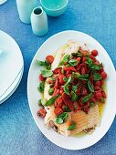 Grilled salmon with cherry tomatoes, olives and basil