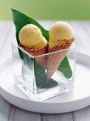 Mango sorbet in a cone