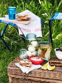 Pickled eggs and tuna, coriander salt, bean puree and crostini for a picnic
