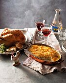 Roast chicken with garlic and dauphine potatoes (France)