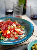 Tomato and pepper salad with boiled egg and ham