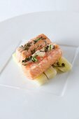 Salmon fillet with capers and lemons on a bed of leek