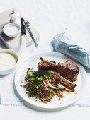 Tandoori lamb cutlets with red lentils, cilantro and yogurt