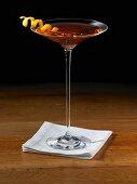 Sorriso Cocktail in a Stem Glass with Orange Peel Twist Garnish