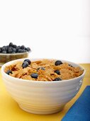 Bowl of Wheat Flake Cereal with Blueberries; Bowl of Blueberries
