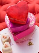 Heart-shaped gift boxes and petit fours