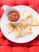 Heart-shaped crisps with a salsa dip