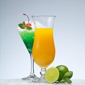 A green cocktail made with peppermint liqueur and a yellow cocktail made with vodka