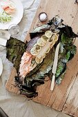 Salmon with tarragon baked in a banana leaf