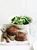 Grilled beef roulade and black cabbage salad with parmesan