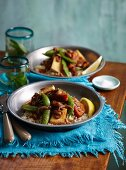 Vegetable curry with tofu and cashew nuts on a bed of couscous
