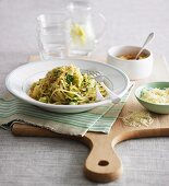 Spaghetti with courgette, crumbles and parmesan