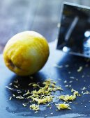 A lemon with the zest grated