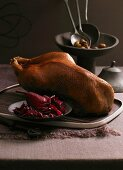 Goose with a chestnut and apple filling on a bed of ginger and pear red cabbage
