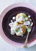 Semolina cakes with a radish and yogurt sauce