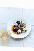 Aubergine rolls with preserved figs and strips of pepper