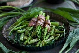 Thai asparagus wrapped in ham with spinach
