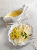 White asparagus soup with sauce hollandaise and potatoes