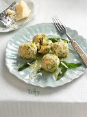 Asparagus dumplings with sage butter and parmesan cheese