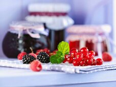 An arrangement of berries and jellies in jars