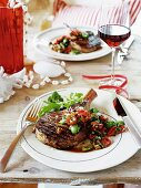 Grilled rib-eye steak with pepper and almond salsa