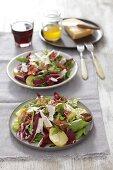 Tyrolean salad with rocket, potatoes, pancetta, Parmesan and garlic vinaigrette