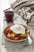 Gröstl (typical Tirolean dish using leftovers - here: fried potatoes with vegetables and a fried egg)