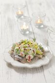 Herring salad with leek, apple, sour cream and red pepper for Christmas
