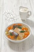 Trout in aspic with carrots, raisins, almonds and horseradish sauce for Christmas