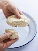 Hands holding homemade ricotta