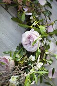 A wreath of pink roses and mistletoe