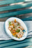 Fried scallops on a fennel and orange salad